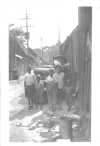 "Photo Album, p. 15, Photo A ""EVICTED"" ""This picture shows the children and furniture of a worker who have been evicted from their alley shack in 1928.""--- Walter and Victor Reuther"