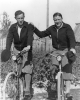 Walter and Victor Reuther riding bicycles.