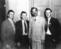 "At home of Mayor Daniel Hoan, Socialist Mayor of Milwaukee, during 1937 Convention.-Left to Right:  Roy Reuther, Walter Reuther, Daniel Hoan, Victor Reuther.""August 1937"""