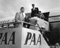 Walter P. Reuther (center, foreground) President of CIO after his arrival at the Tulln airport.  Mr. Reuther is accompanied by Mrs. Reuther, their 11-year-old daugher Linda and Victor Reuther, a brother of the CIO leader.  July 30, 1953