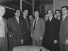 Reuther stop-over Beirut April 3, 1956, Beirut International Airport.  Left to Right:  Ahmad Shuman, Jam'iat Secretary General, Khudar Dayye, President, Cinema Projectionist Union; Habib Haddad, President, Cinema Distributor Employees Union; Elias Khoury, Secrectary, Private Car Drivers Union; Walter Reuther; Aziz Wasin, President, Theatre Employees Union; Nouri Boudali, ICFTU Middle East Represenative; Joseph Hayeck, President, Transport and Travel Agency Employees Union; Wadi' Sim'aan, President, Jam'iat Federation.  April 3, 1956