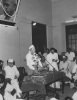 Bombay City---Reuther addressing the INTUC workers, Gandhi's portrait hangs in the background.  Also a view of some of the attentive workers listening to the address.
