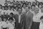 "Israel---in Holon, near Tel Aviv, for dedication of Youth Hostel, posed with unidentified man and group of young Israeli girls.""May 17, 1961"