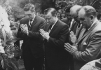 "Walter Reuther is shown honoring the memory of the founder of trade unionism in Japan.  A UAW delegation places a wreath and burns incense at his grave.""November 18, 1962"