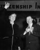 """First Lady of the World"" - Mrs. Eleanor Roosevelt waves a greeting to delegates of CIO President Walter Reuther.  Reuther applaudes her vigorous address.-December 13, 1954-CIO Covention L.A. 1954"