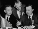"Arthur Goldberg, Jacob Potofsky, and Walter P. Reuther in a serious discussion.""November 1951"""