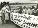 "West Berlin - UAW group arrives carrying sign ""Freedom will not be Walled In UAW Greets Free Berlin""""July 1962"""