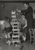 Walter Reuther playing with blocks with some children while visiting Vienna.  July, 1953