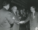 Walter Reuther shaking hands with George Meany (UAW convention), ca. 1952