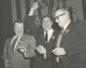 Walter Reuther, unidentified and George Meany, AFL and CIO Merger Convention, 1955.