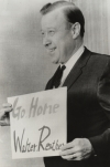 "United Auto Workers President Walter P. Reuther is shown in San Francisco holding a sign that was thrown into his car by Communist hecklers on his recent tour of Japan.  Reuther spent 10 days in Japan helping to coordinate efforts by the Japanese and American labor movements.""November, 1962"